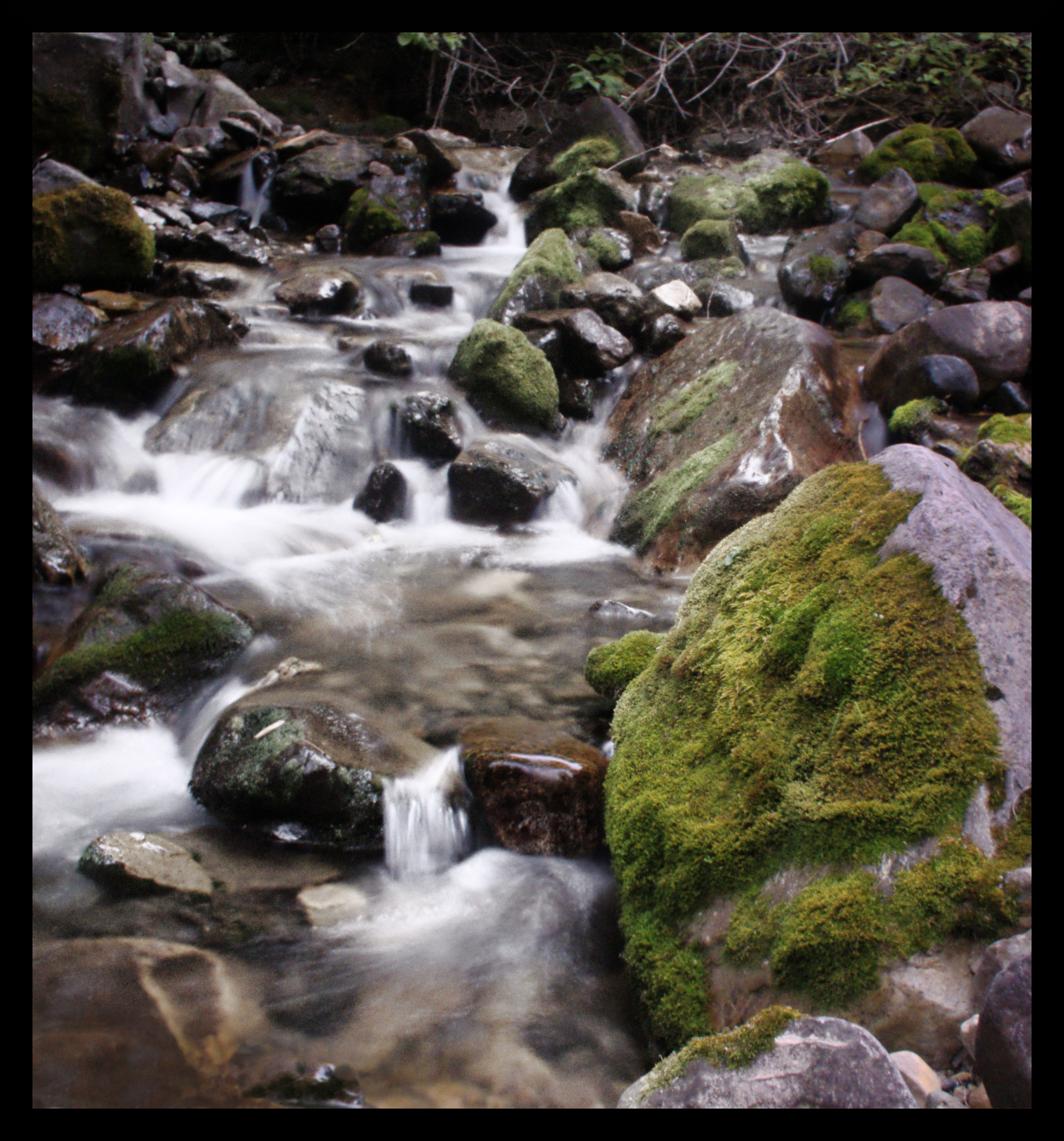 A river rushes through rocks