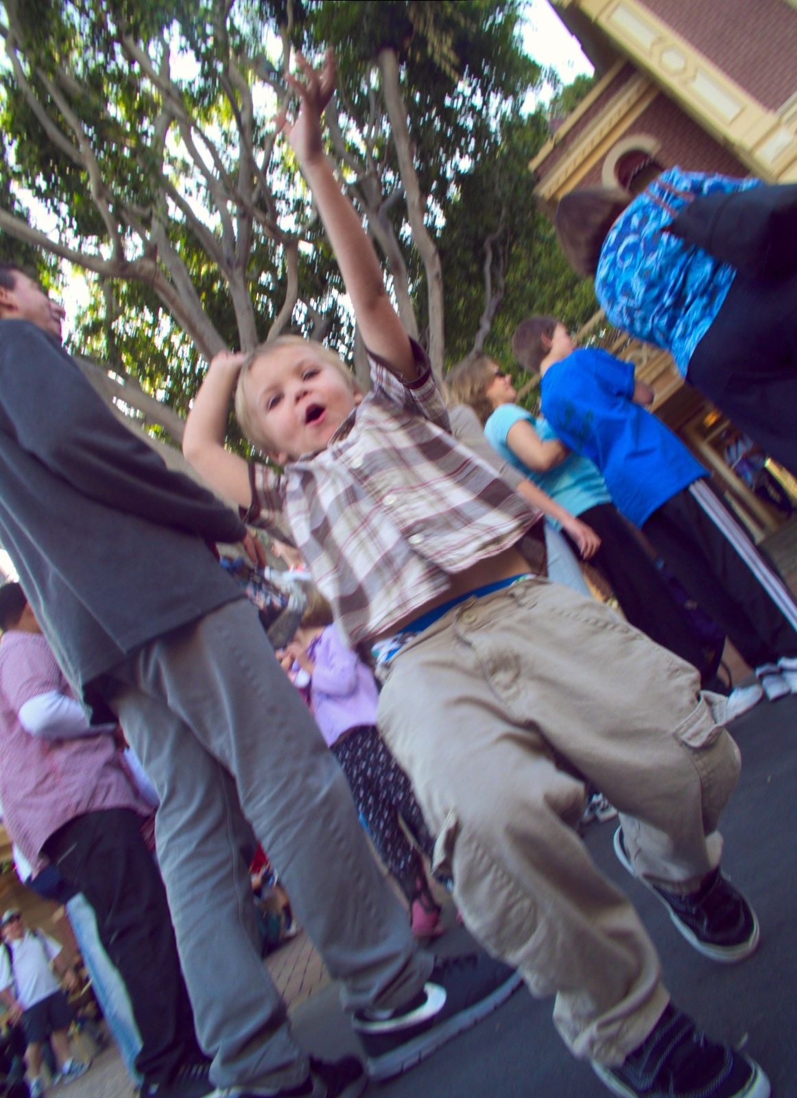 A little boy excited to be at disneyland