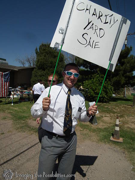 Missionaries doing a charity yard sale